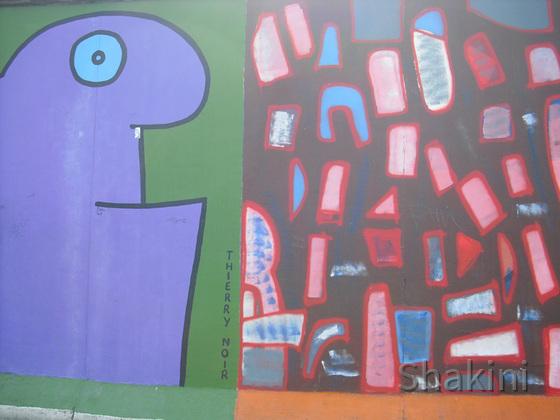 East Side Gallery - Berlin - Graffitis - Karikatur - Thierry Noir