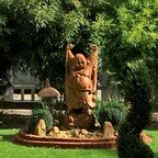 Pagoda Garten - Fröhlicher Buddha